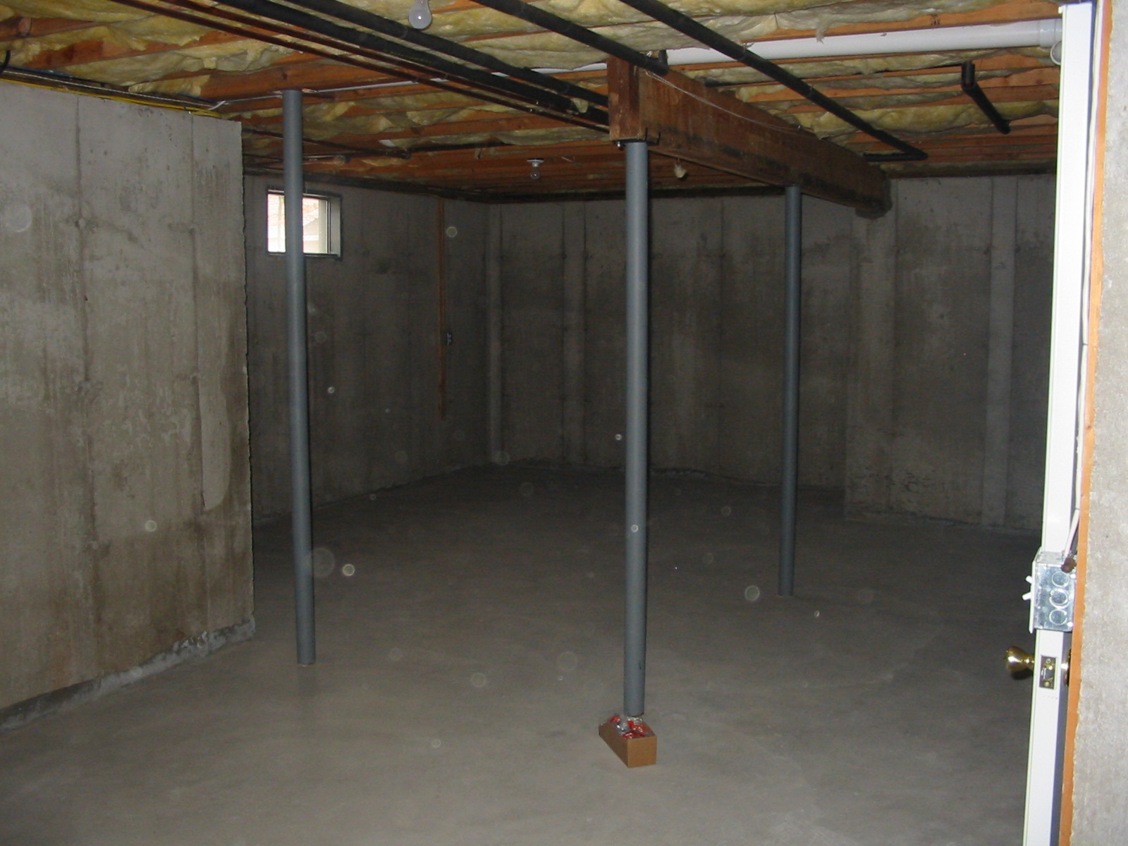 insulation is in the basement ceiling under the first floor